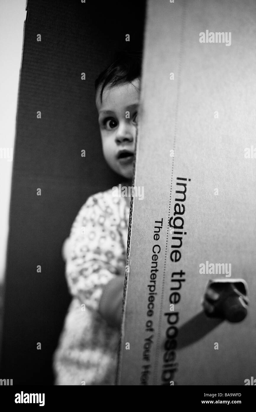 A small boy behind a box, Sweden. - Stock Image