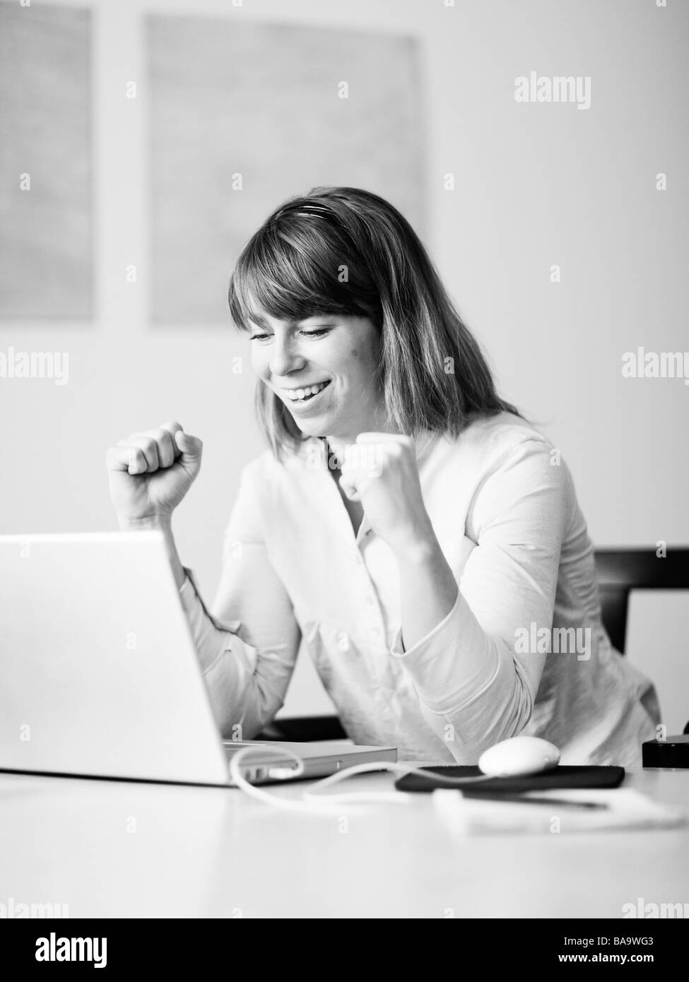 A woman using a computer, Sweden. - Stock Image