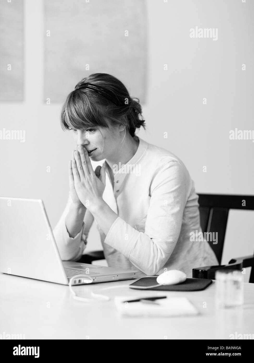 A woman using a laptop, Sweden. - Stock Image