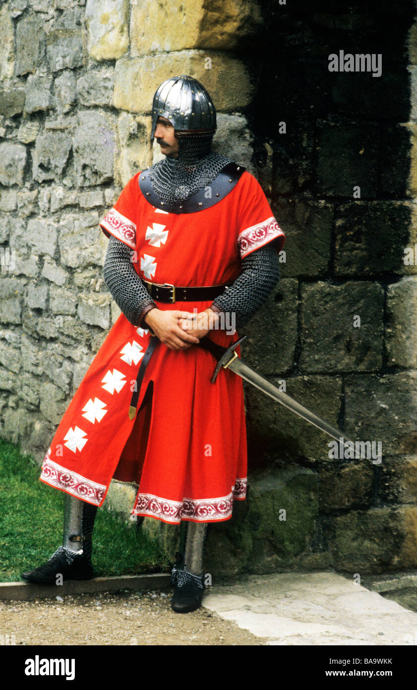 Medieval Knight in armour English historical re-enactment England UK costume armour sword helmet weapons weaponry - Stock Image