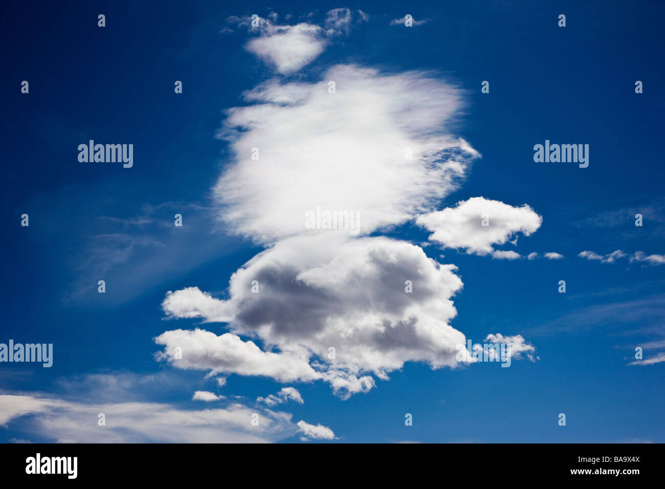 Puffy white clouds on a clear blue sky near Placerville Colorado USA - Stock Image