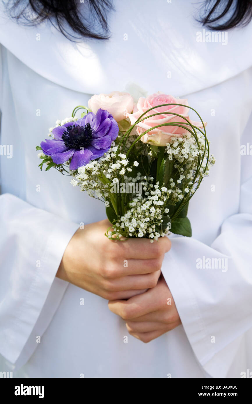 Confirmand with flowers, Sweden. - Stock Image