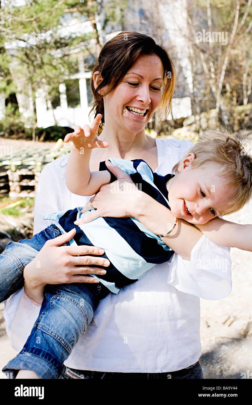 Mother holding her son, Stockholm, Sweden. - Stock Image