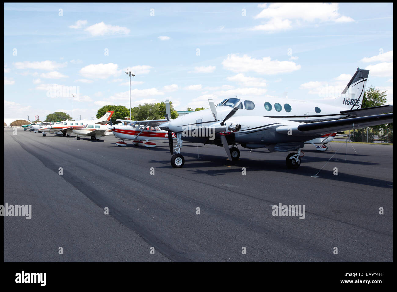Planes secured on a airstrip in Orlando - Stock Image