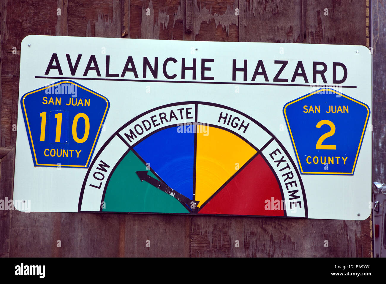 Avalanche Hazard warning sign posted on a building in historic Silverton Colorado USA - Stock Image