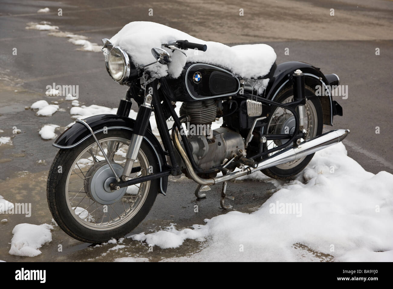 Snow covered BMW motorcycle parked in the town of Silverton Colorado USA - Stock Image