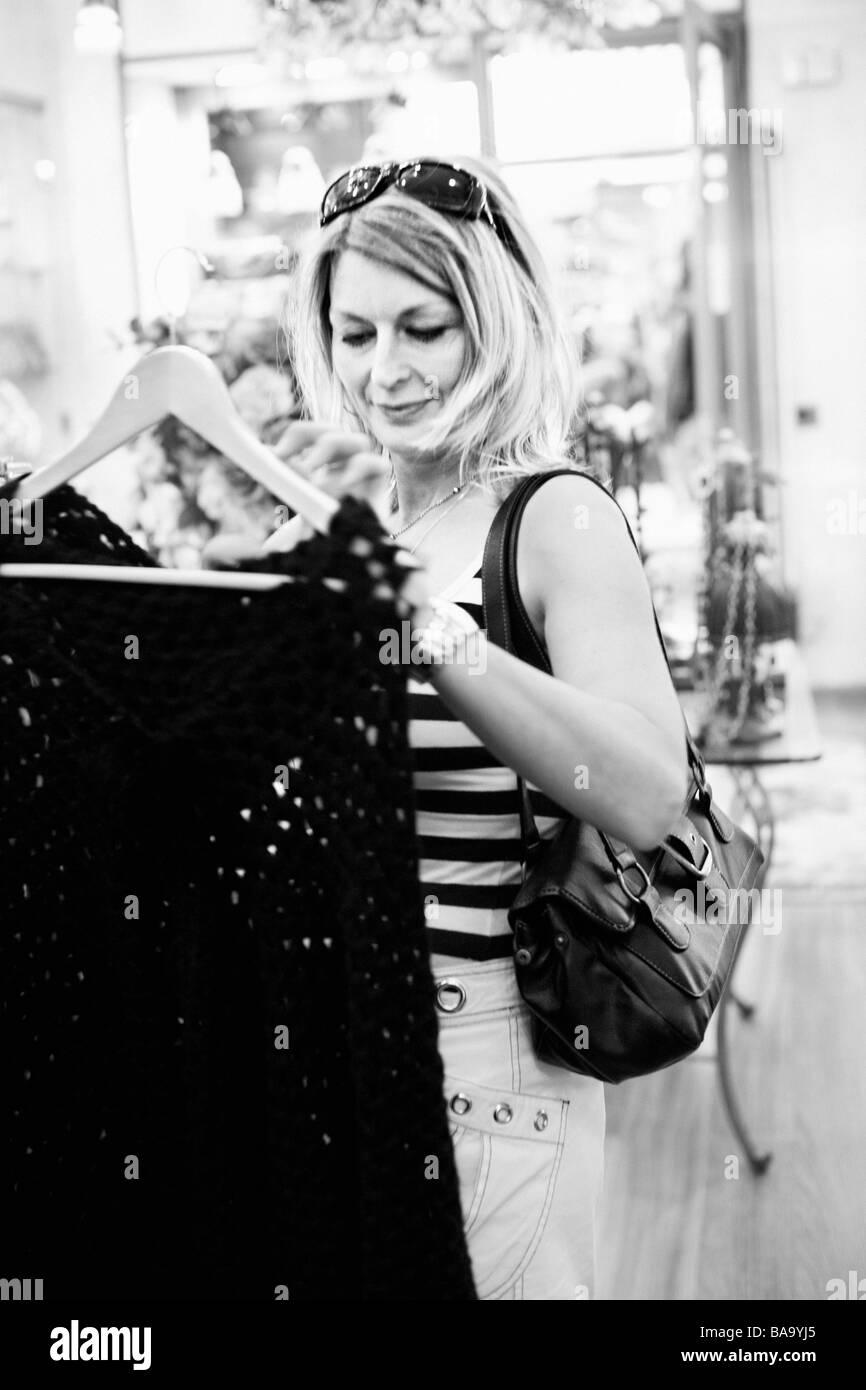 A Scandinavian woman shopping, Mallorca. - Stock Image