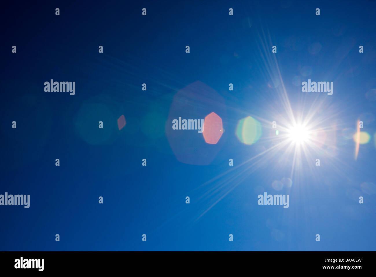 Sunburst against a crystal clear blue Colorado sky - Stock Image