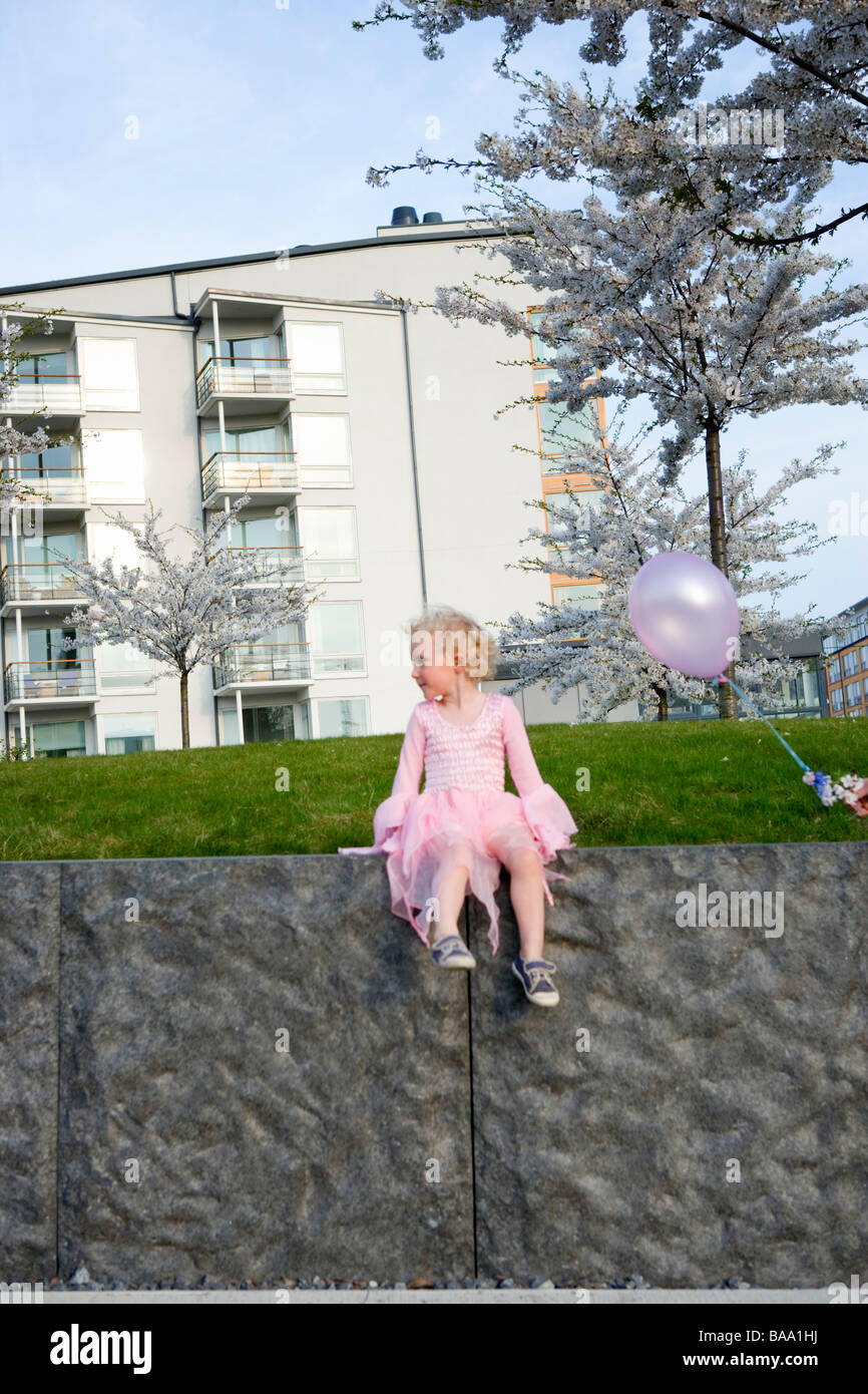 A little girl in a pink dress, Sweden. - Stock Image