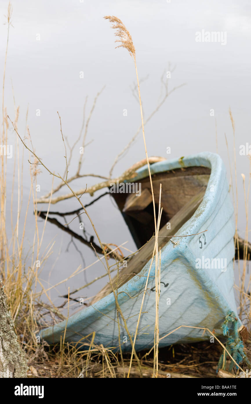 A boat half covered with water Sweden - Stock Image