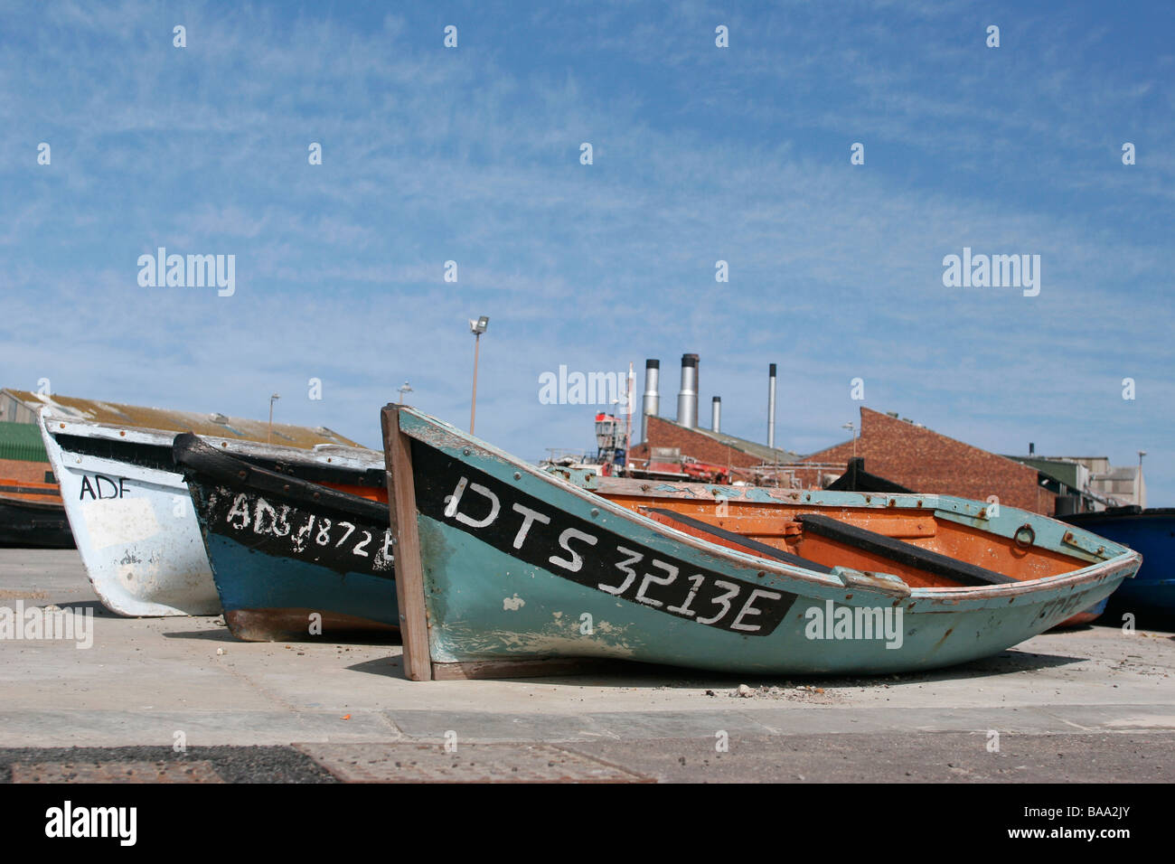 Fishing boats lie on the beach in the West Coast coastal