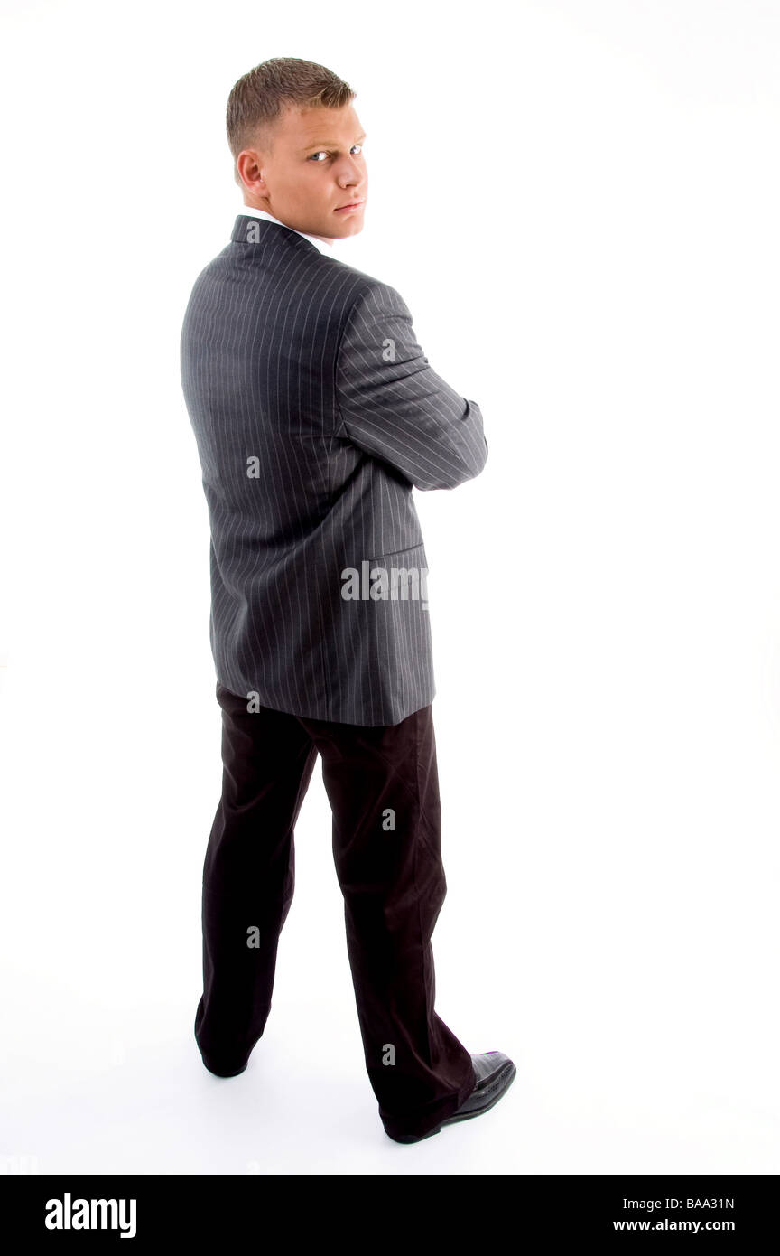 back pose of standing handsome businessman - Stock Image