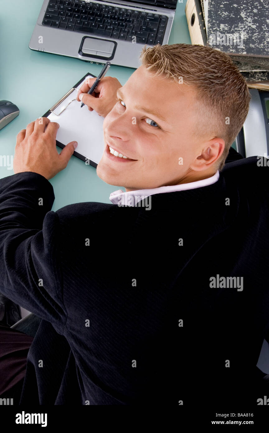 back pose of smiling boss with pen and writing board - Stock Image