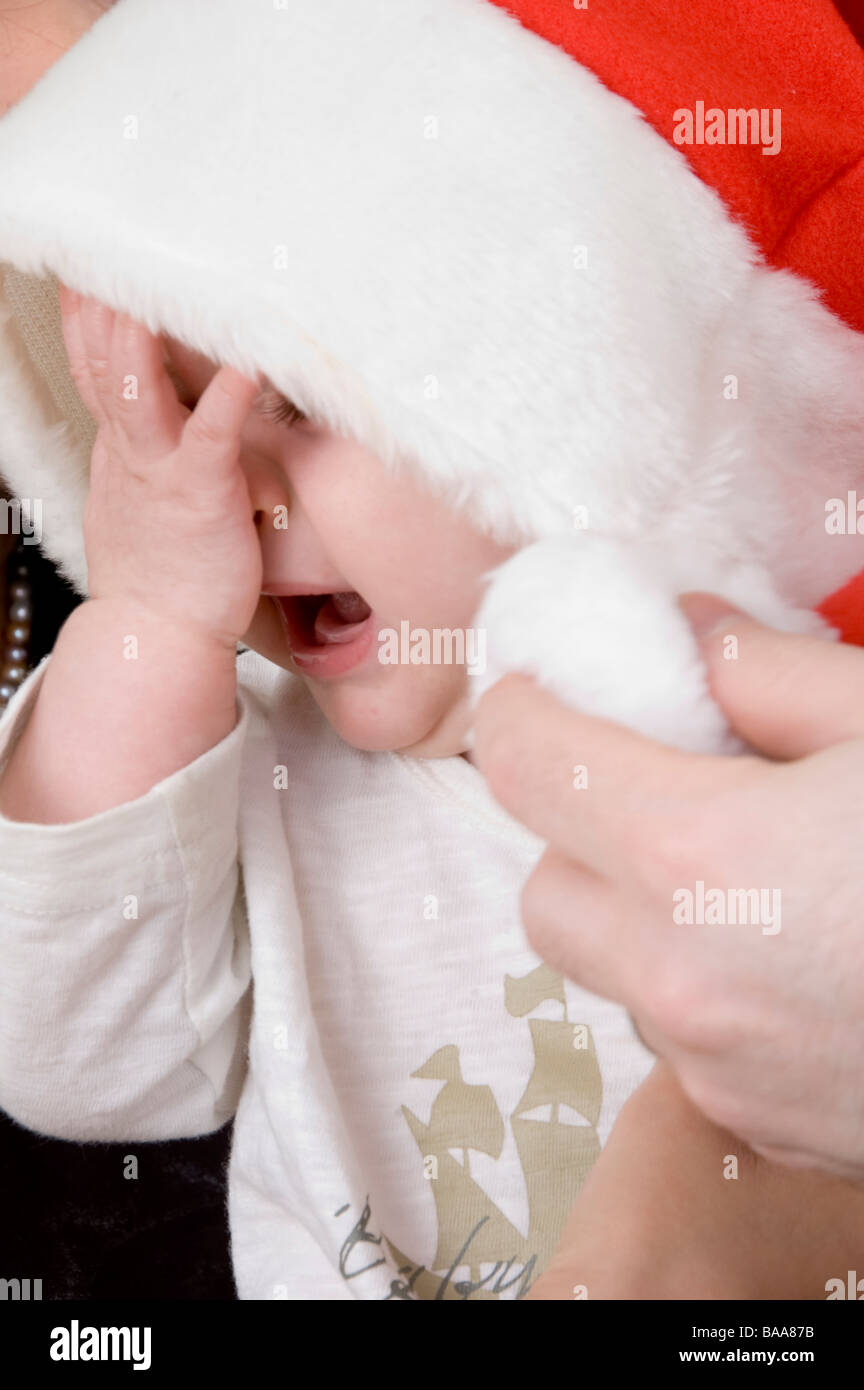 crying baby with christmas hat Stock Photo