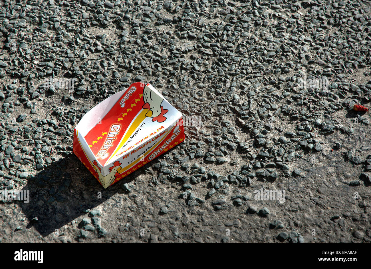 Flavourite Chicken box thrown out of a car onto a road - Stock Image