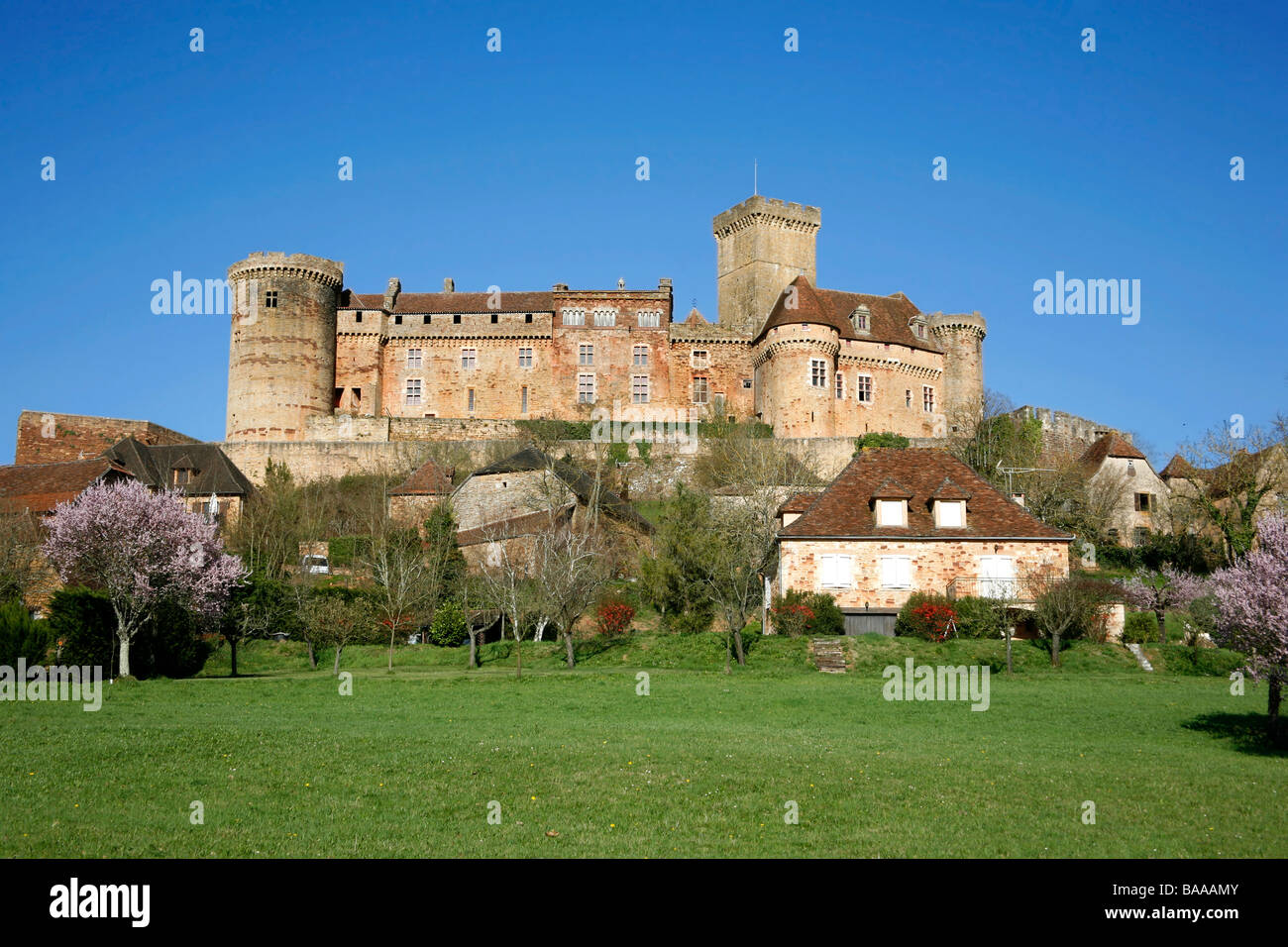 Castle and old village of Bretenoux in green fields France Stock Photo