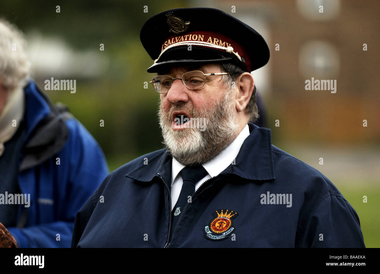 A member of The Salvation Army singing at an outdoor service in Brghton UK - Stock Image