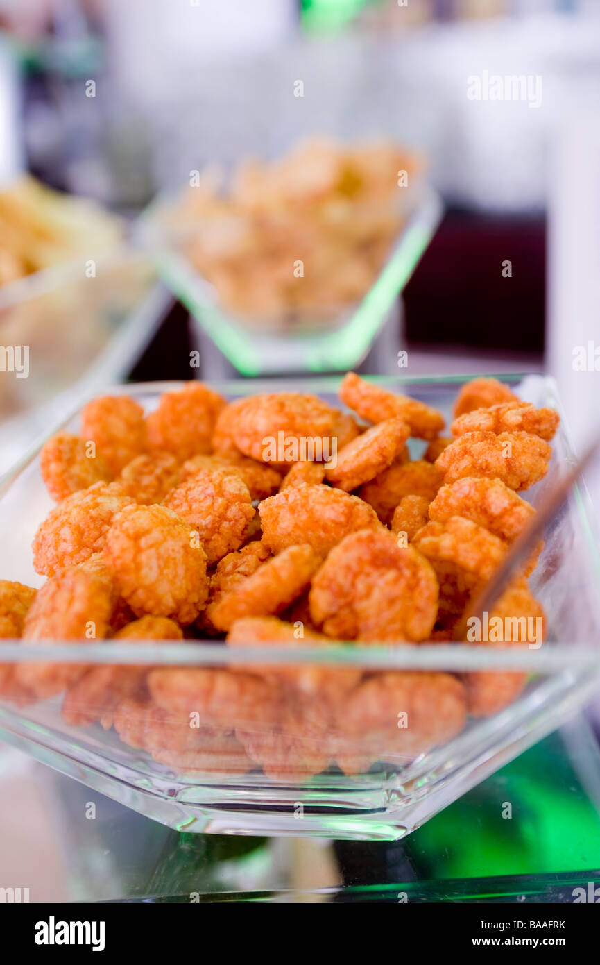 Savory snacks in an upscale bar. Milan. Italy. - Stock Image