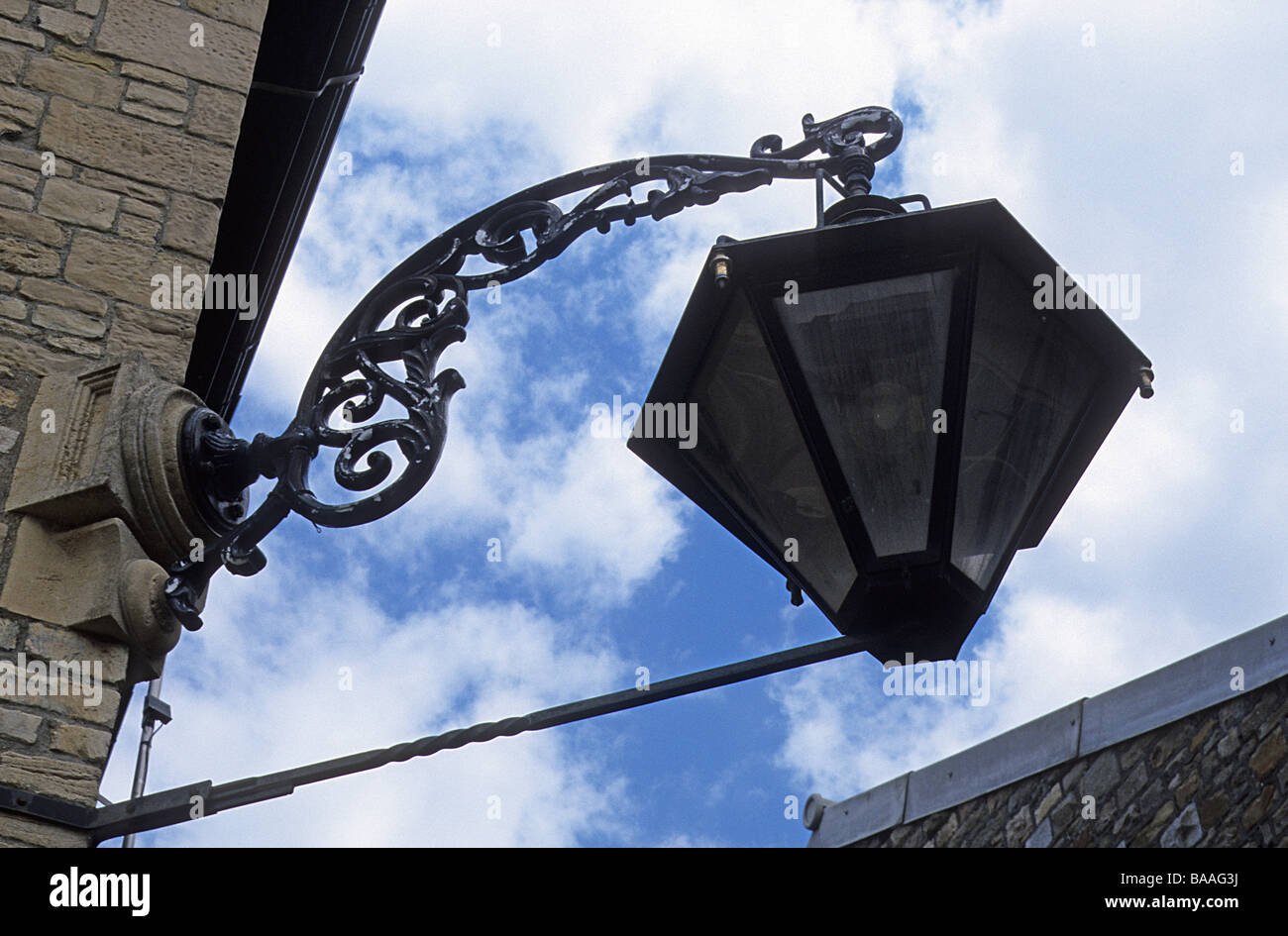 Swindon Railway Works, Wiltshire, large and elaborate lamp bracketed off building. - Stock Image