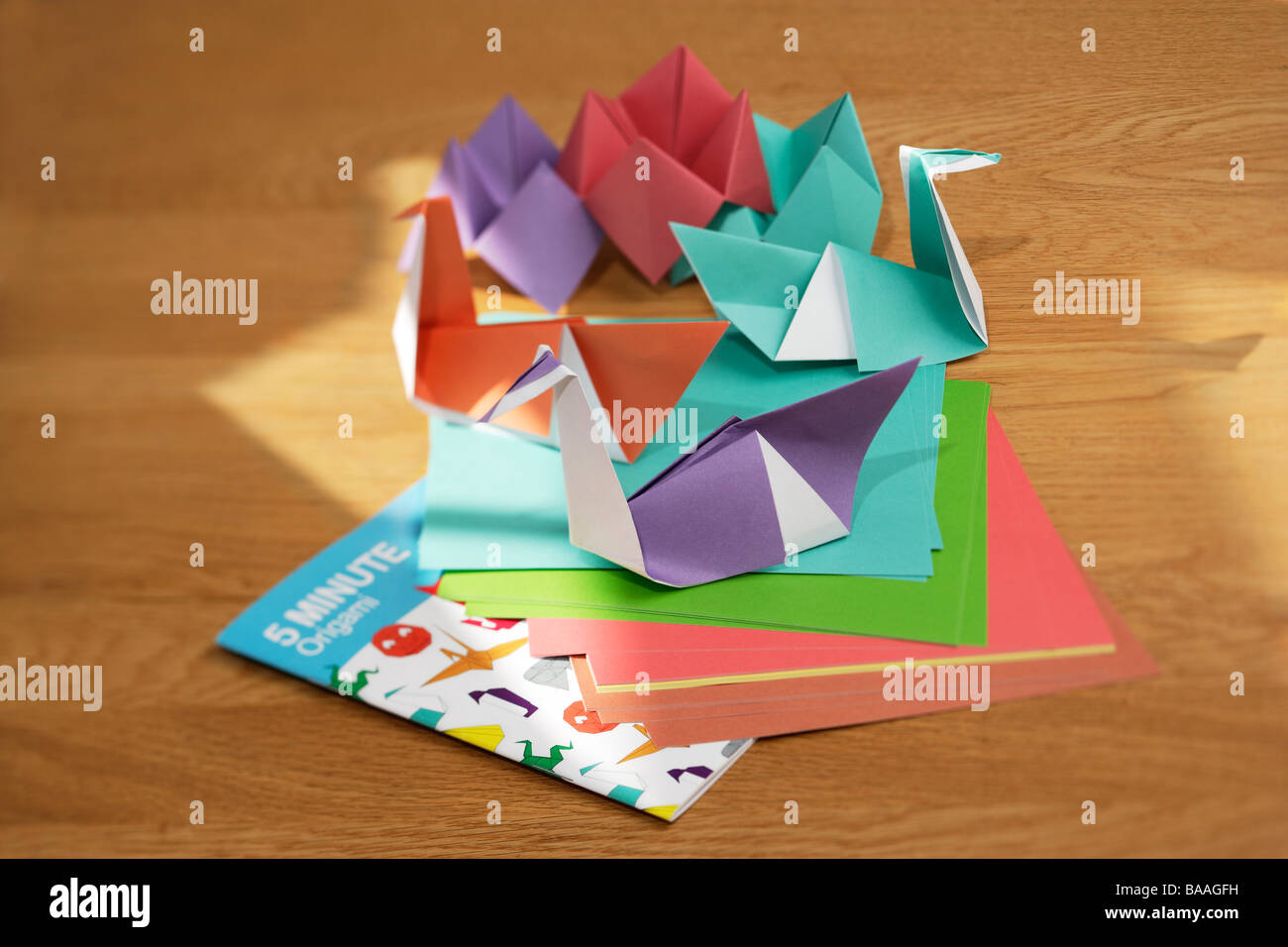 Origami swans Making things from paper - Stock Image