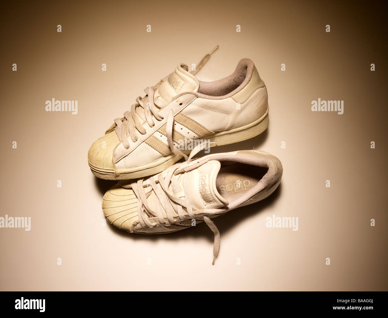 Old pair of trainers sneakers - Stock Image