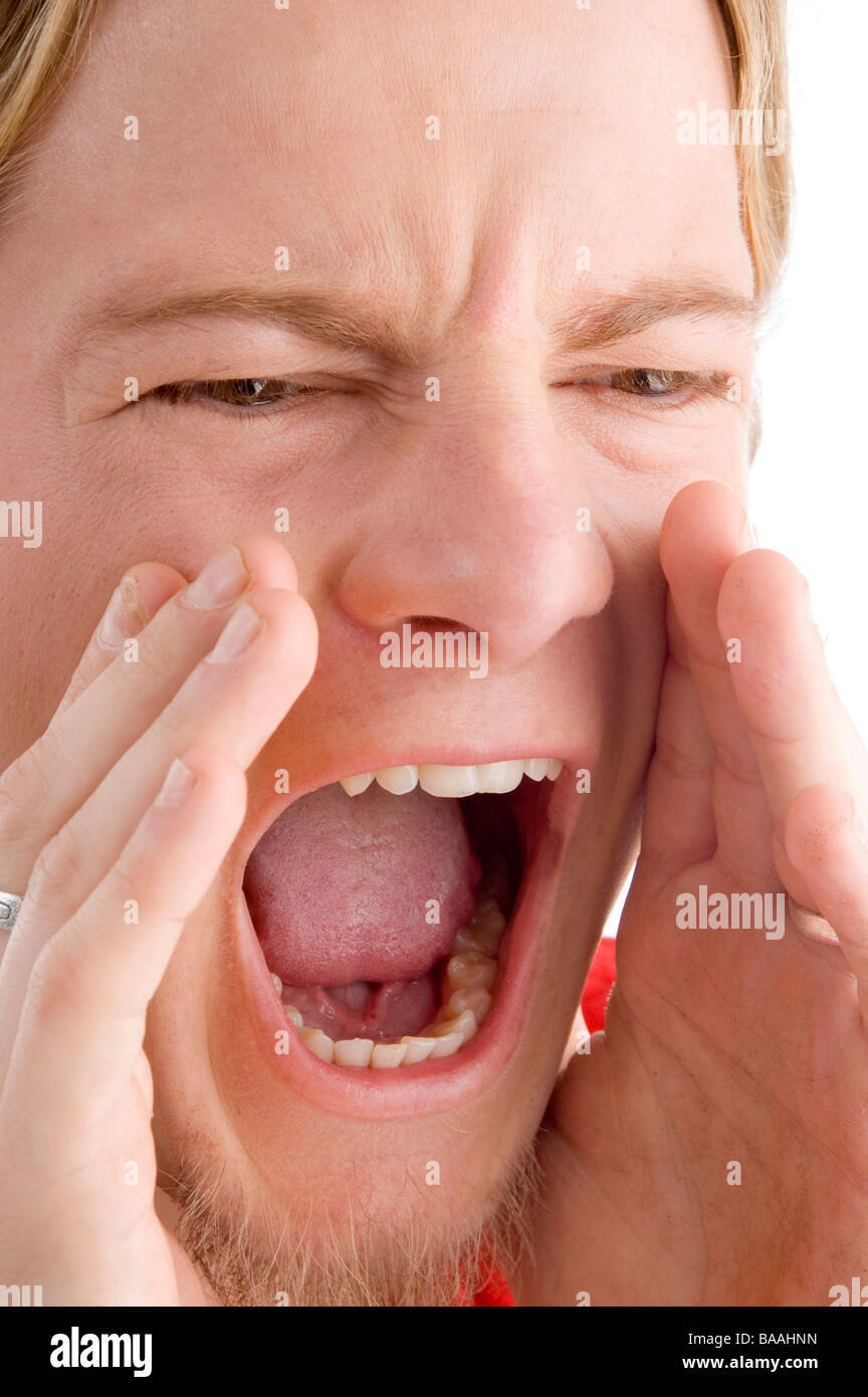 face of male shouting loudly - Stock Image