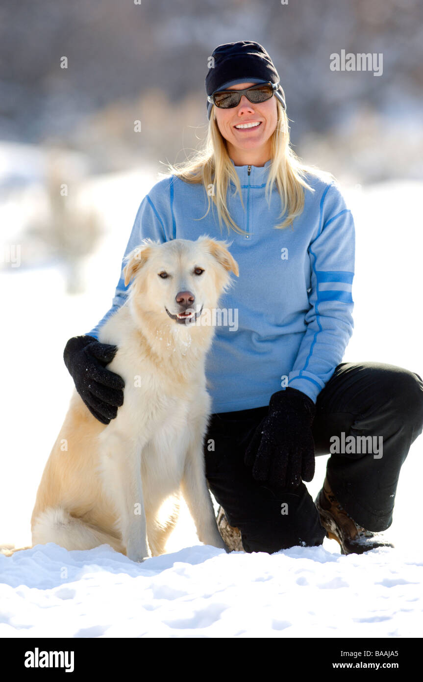 Woman hanging out with dog in Salt Lake City, Utah. - Stock Image