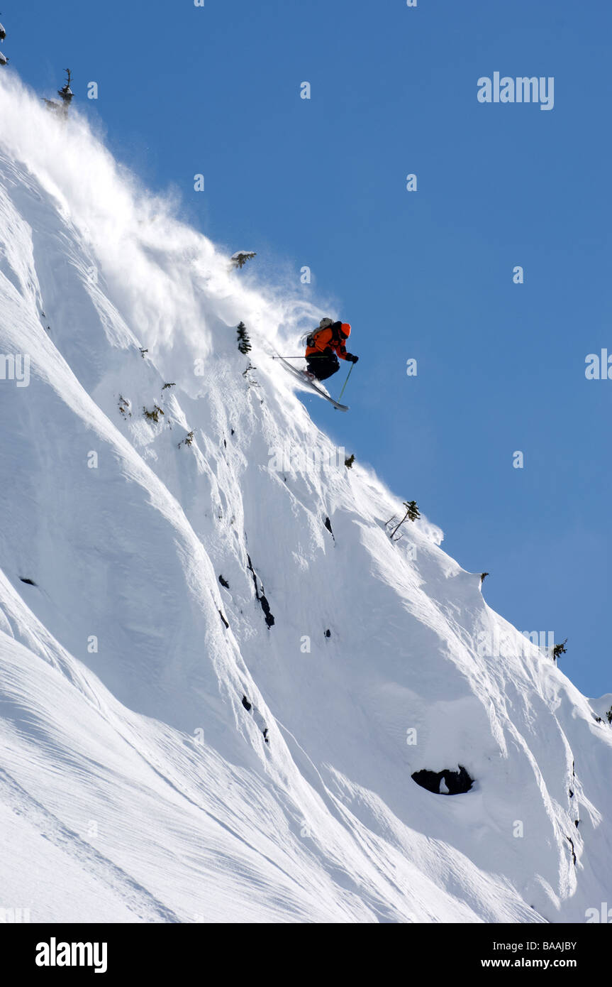 Man heli skiing in Terrace, BC, Canada. - Stock Image