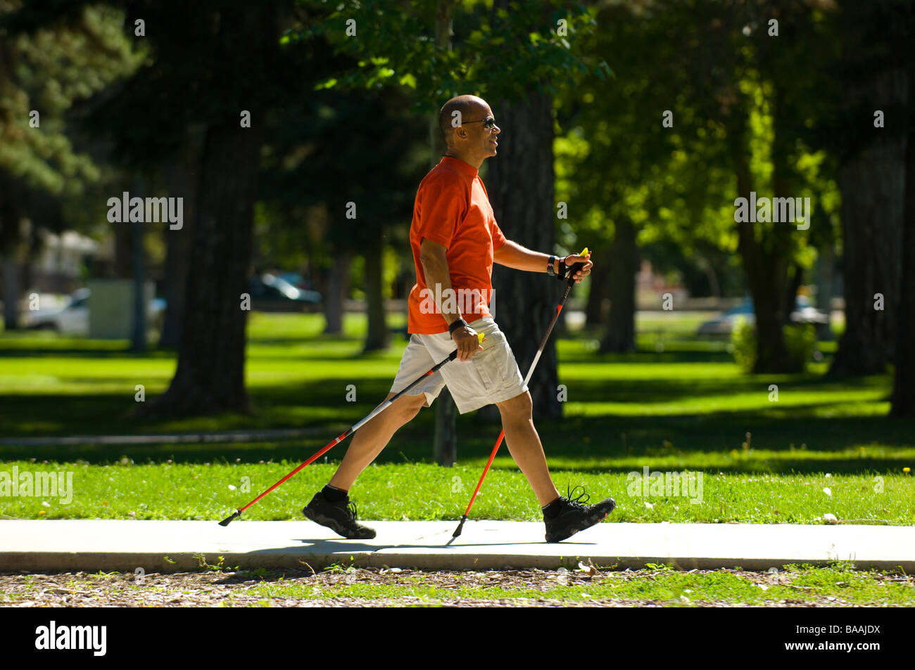 Man nordic walking in Salt Lake City, Utah. - Stock Image
