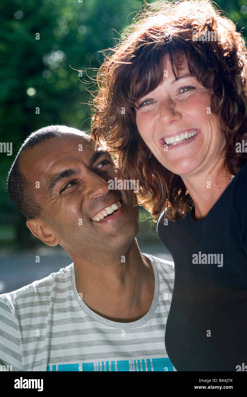 A woman sitting in a man''s lap, Stockholm, Sweden. - Stock Image