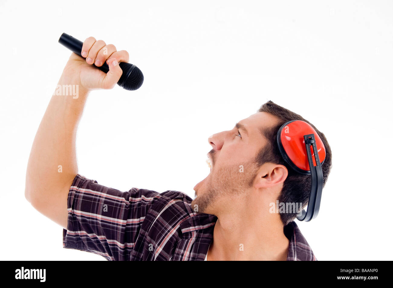 male singing loudly on microphone - Stock Image