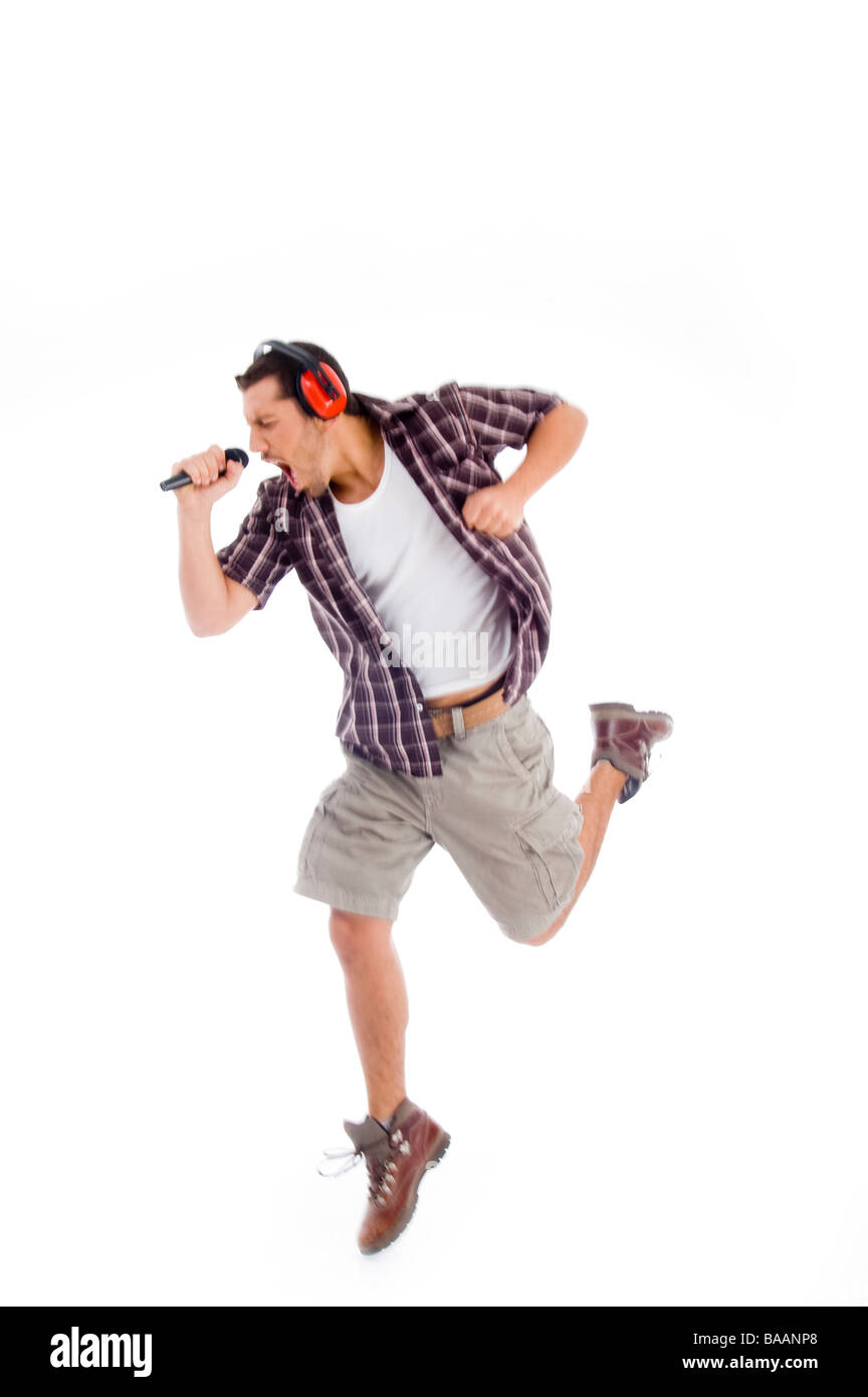 singer singing loudly in to microphone - Stock Image