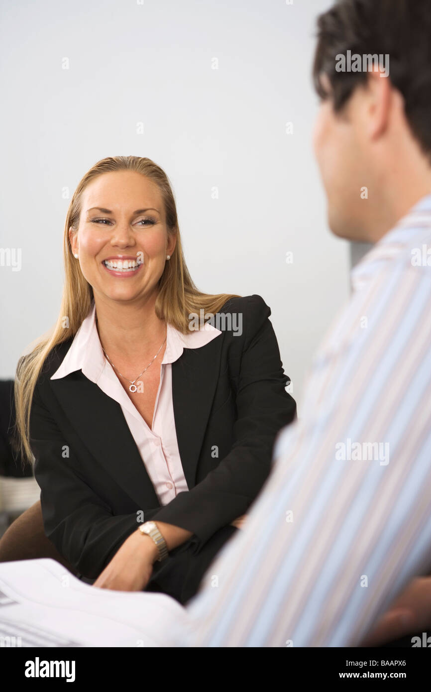 A smiling woman in an office. Stock Photo