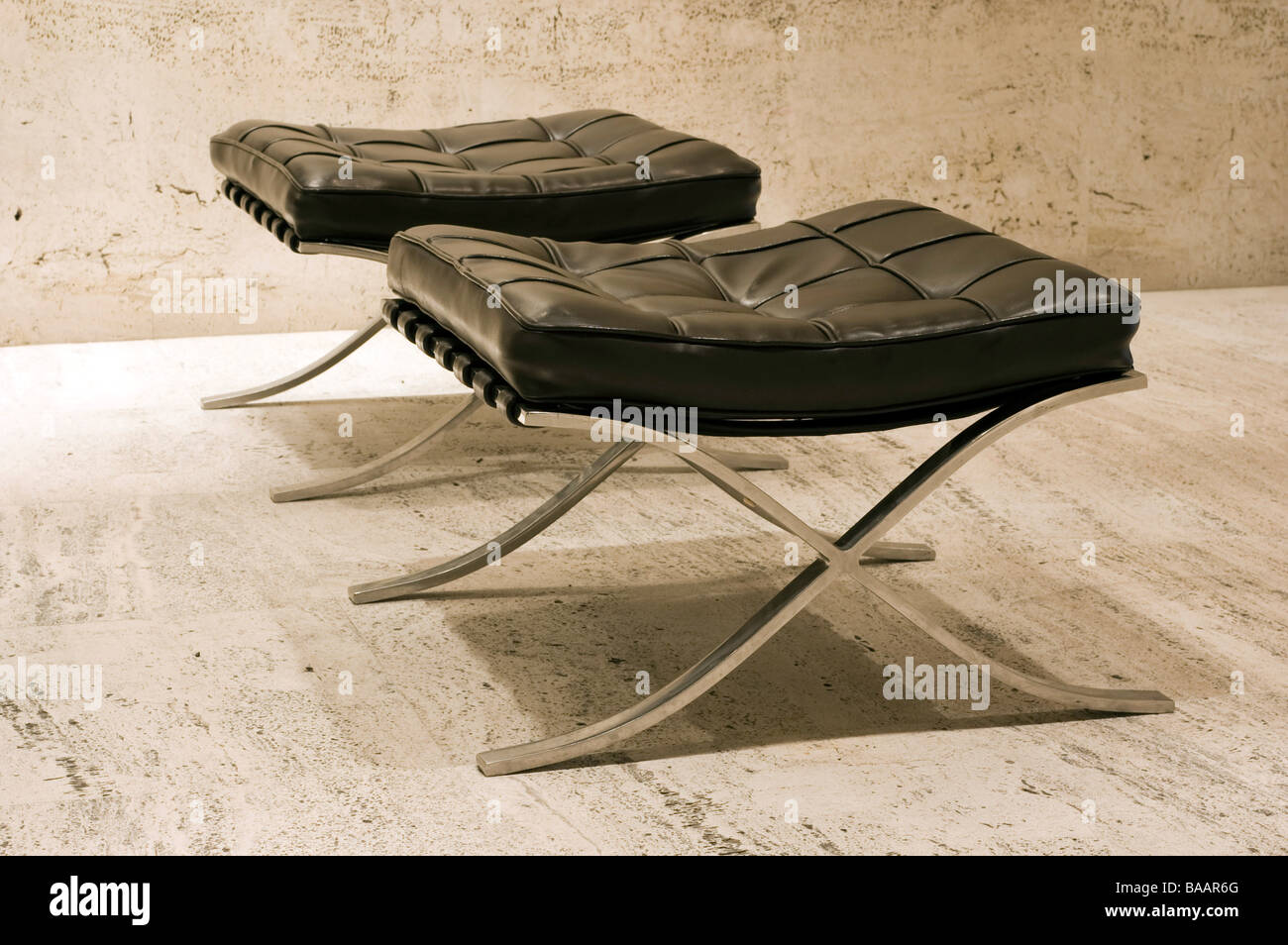 Two Barcelona Ottomans, designed by Ludwig Mies Van Der Rohe and Lilly Reich (For Editorial Use Only) - Stock Image