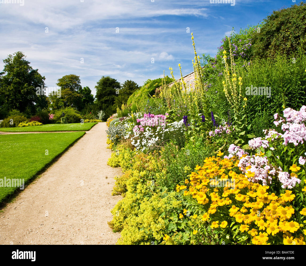 Colourful herbaceous perennial summer border on a sunny day at Waterperry Gardens Wheatley Oxfordshire England UK - Stock Image