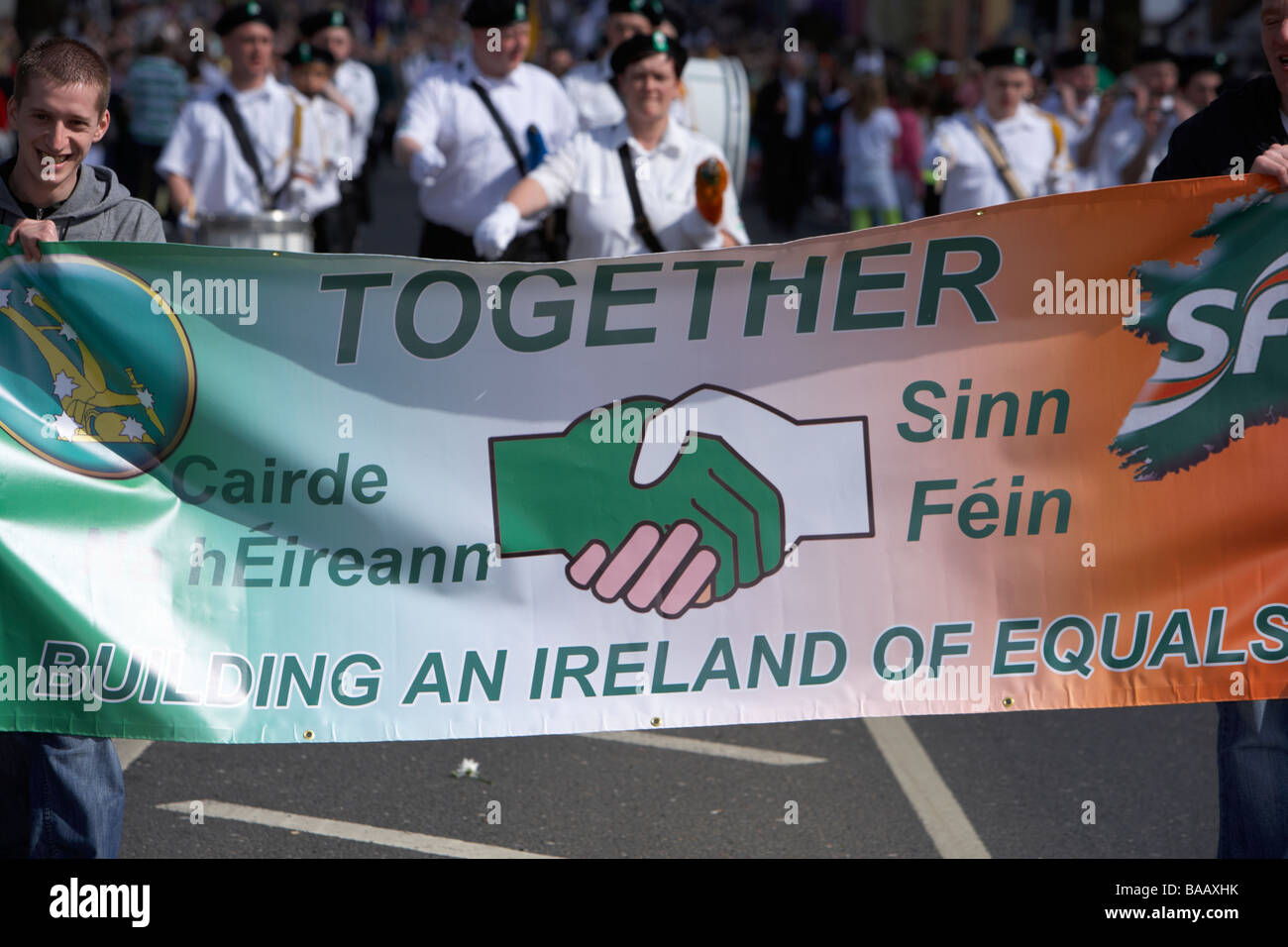 Sinn Fein ireland of equals together banner being carried on Easter Sunday during Easter Rising Commemoration Falls - Stock Image
