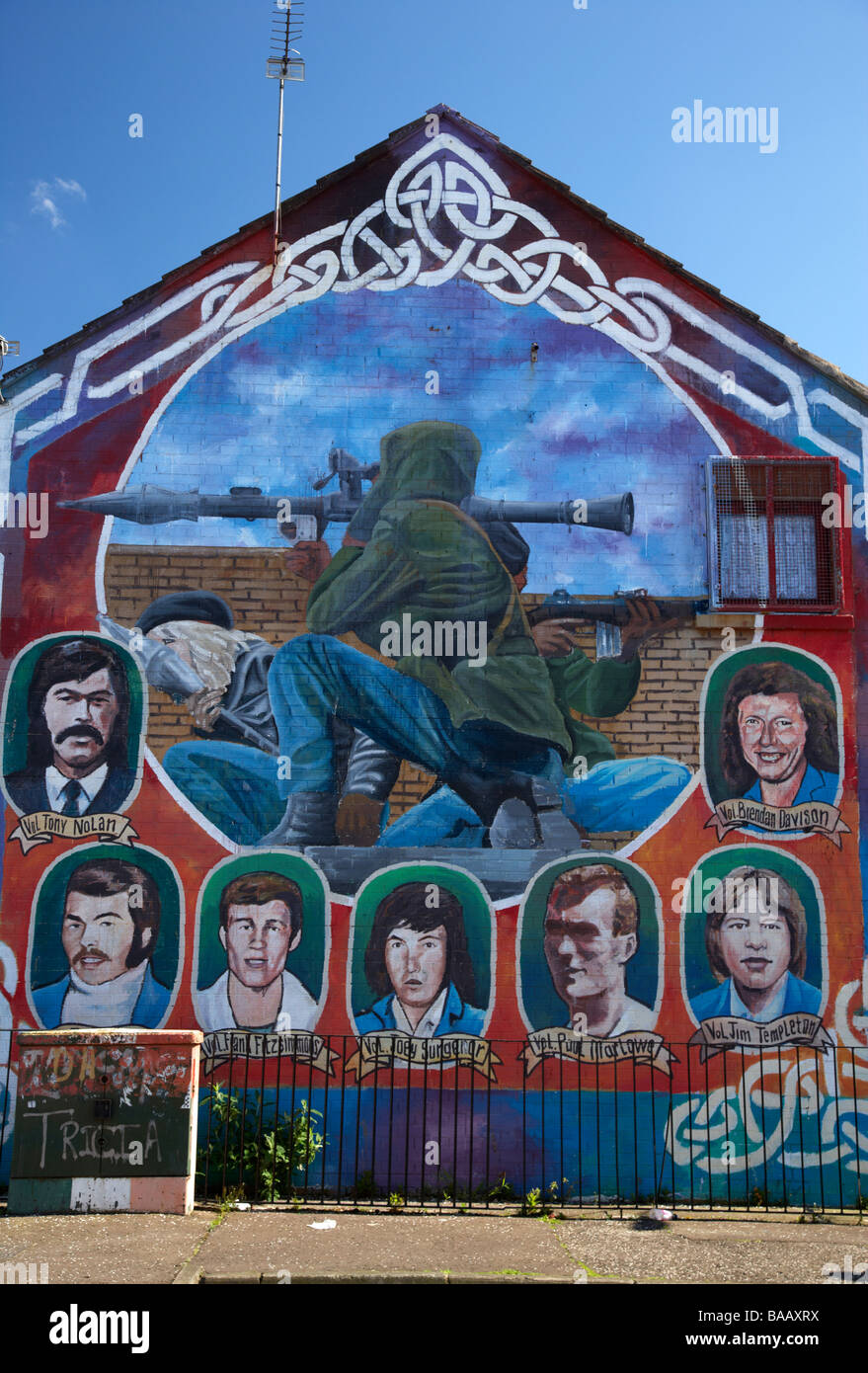 IRA republican mural showing dead volunteers and IRA RPG rocket attack in progress painted in the markets area of - Stock Image