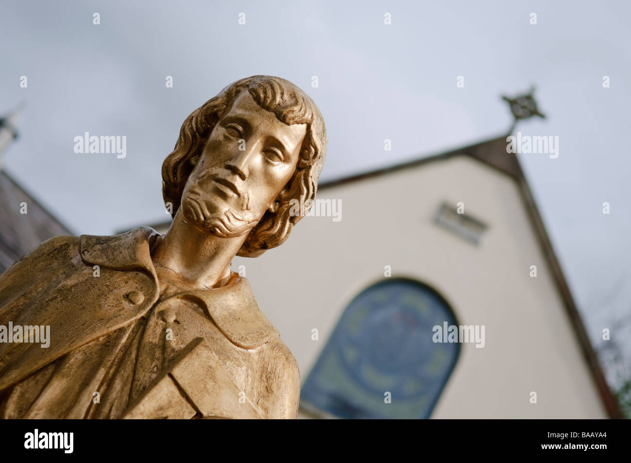 Guild/guilded/gold statue of Jesus outside a Catholic Church/Chapel - Stock Image