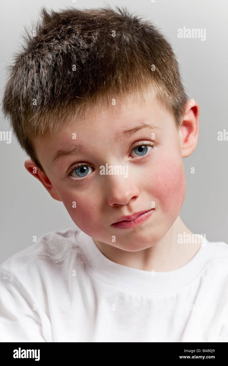 Sad little boy looking to camera - Stock Image