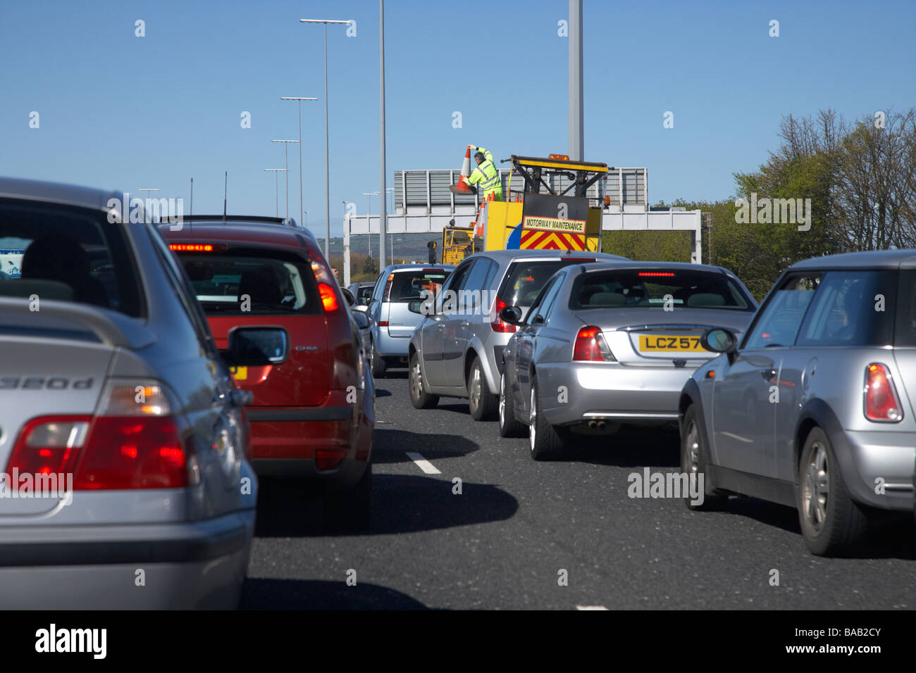 motorway maintenance crew working on a motorway with traffic jams and disruption M2 outside Belfast in Northern - Stock Image