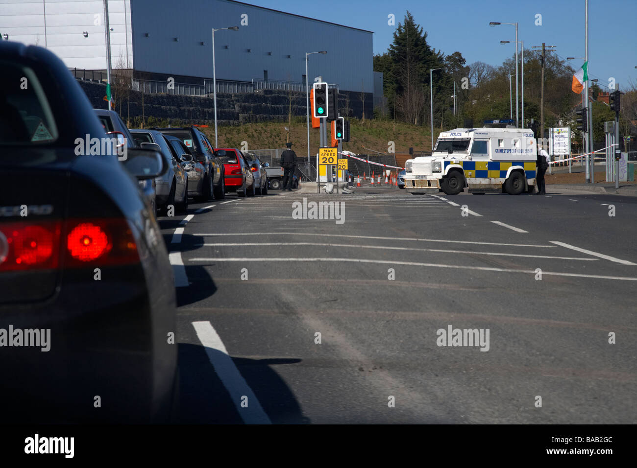 psni police roadblock and traffic jam as a result of a security alert of a suspicious object placed by dissident - Stock Image
