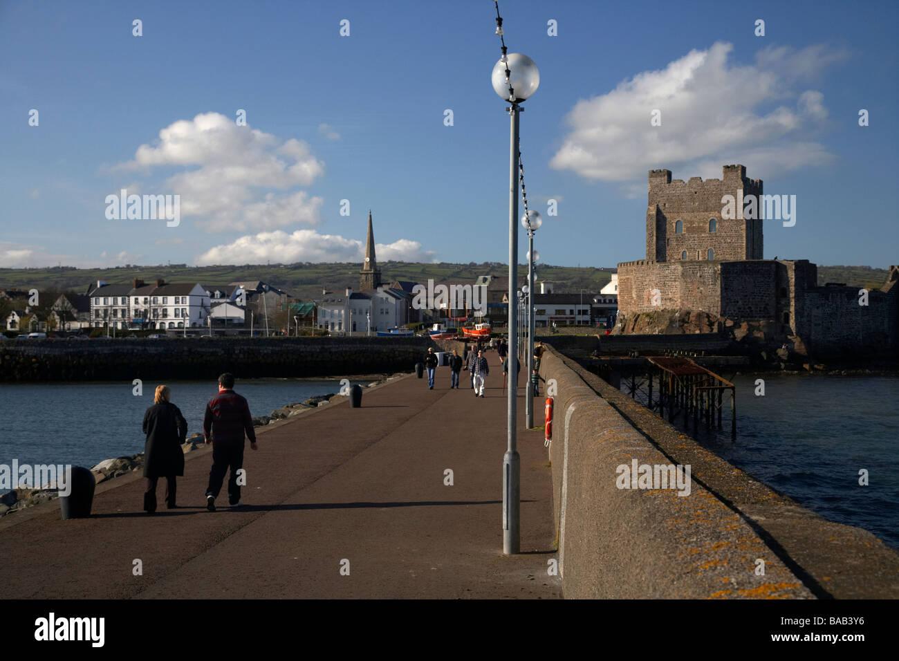 carrickfergus harbour and albert edward pier promenade and castle county antrim northern ireland uk - Stock Image