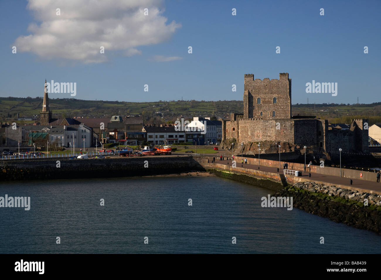 view of carrickfergus town and castle from albert edward east pier in carrickfergus harbour county antrim northern - Stock Image