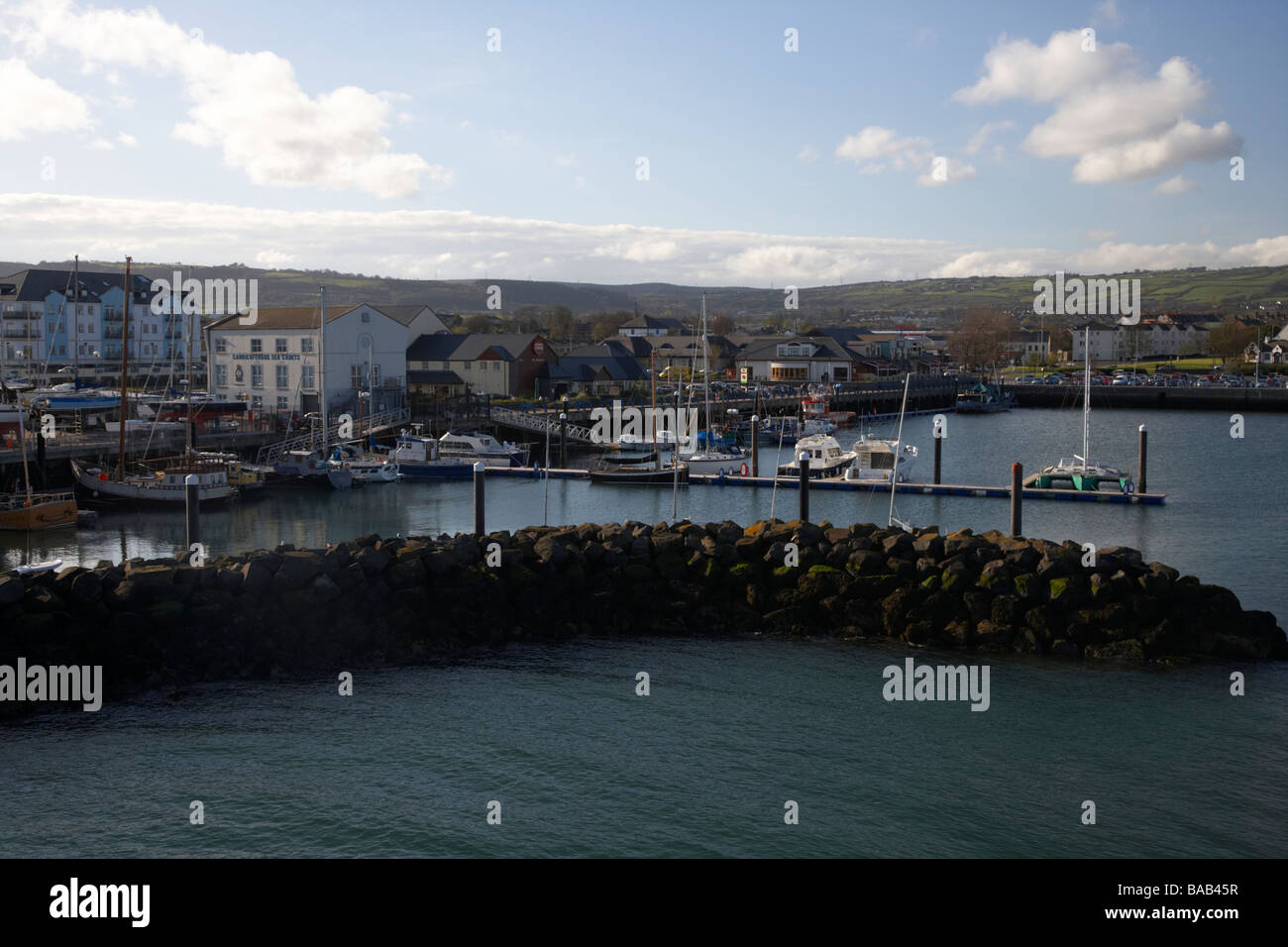 view of carrickfergus town and harbour from albert edward east pier in carrickfergus harbour county antrim northern - Stock Image