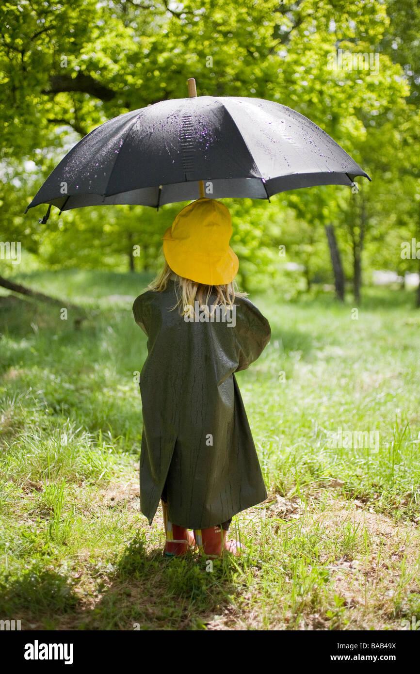 A little girl in the rain, Sweden. - Stock Image