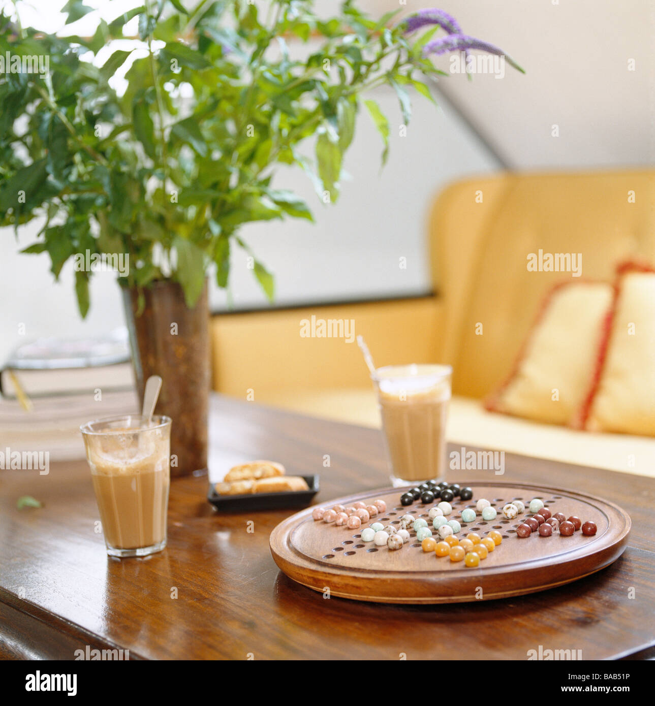 Caféé Au Lait And A Game Of Chinese Chequers. - Stock Image