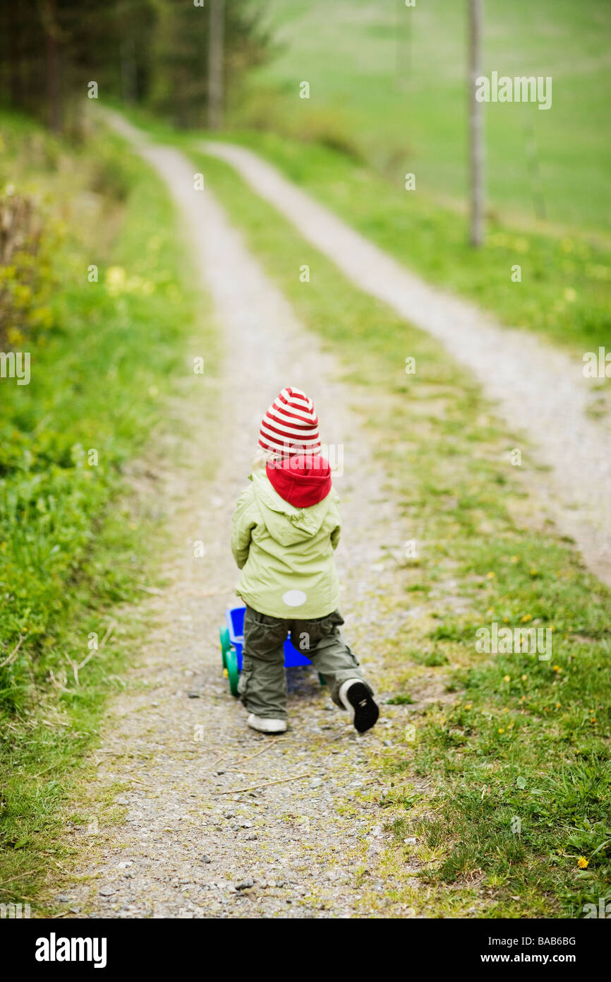 A girl with a cart, Sweden. - Stock Image