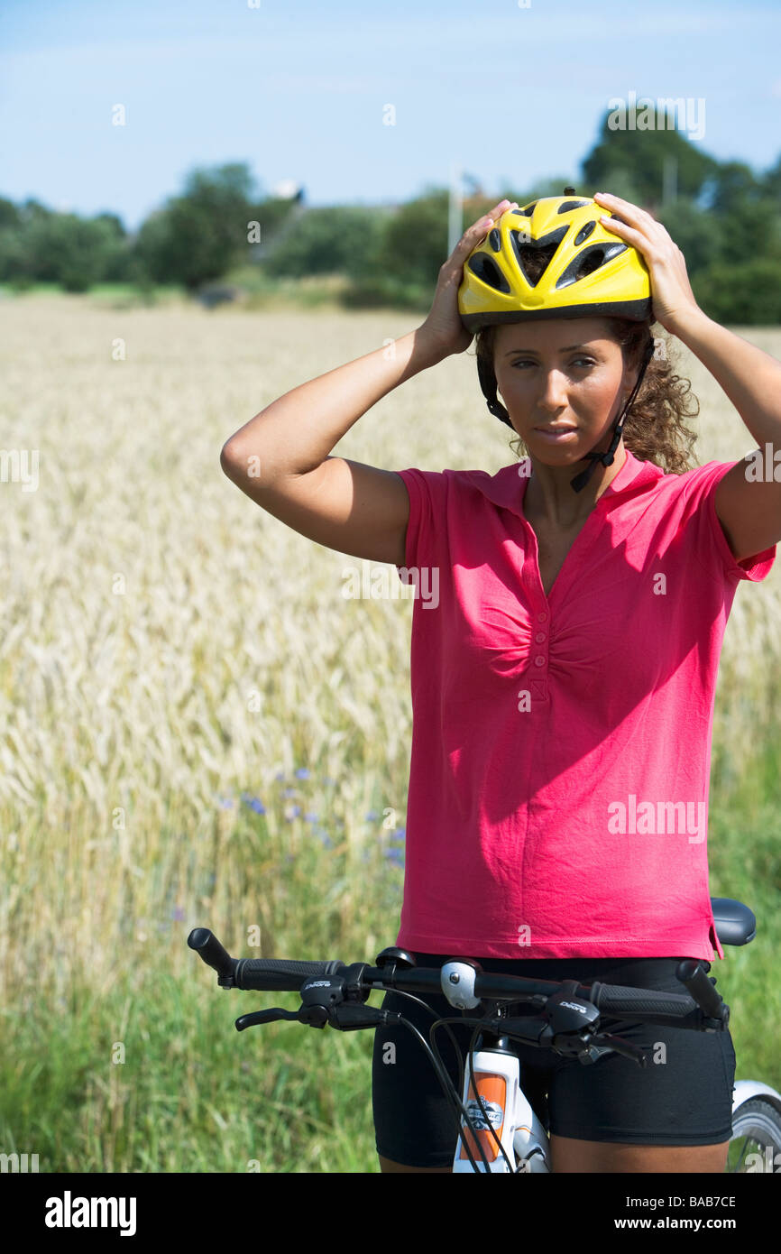 A woman wearing a safety helmet, Sweden. - Stock Image