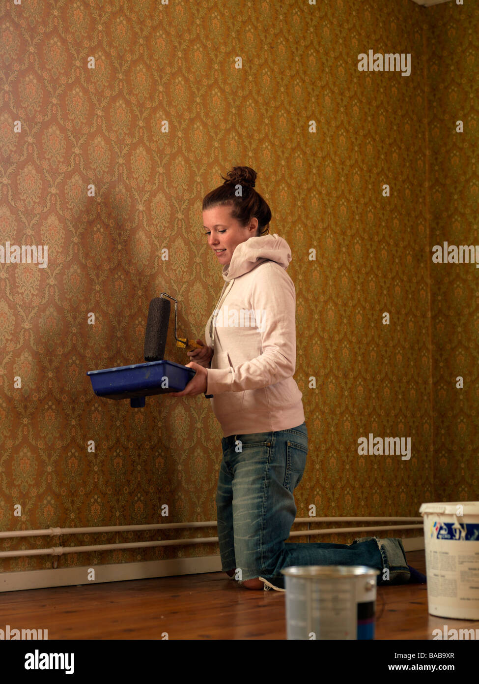 A young woman renovating a room Sweden. - Stock Image