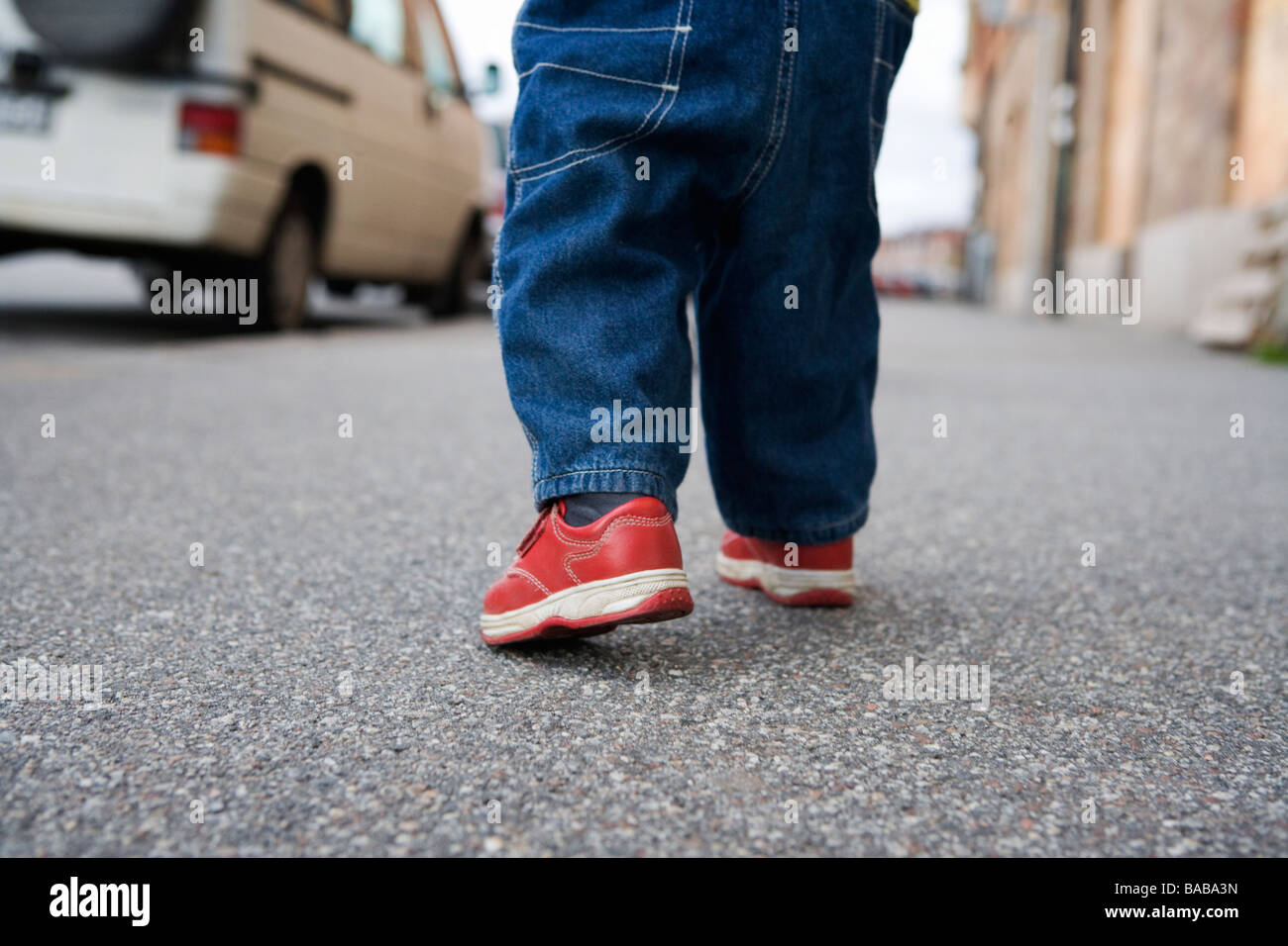 The legs of a child walking Sweden. - Stock Image